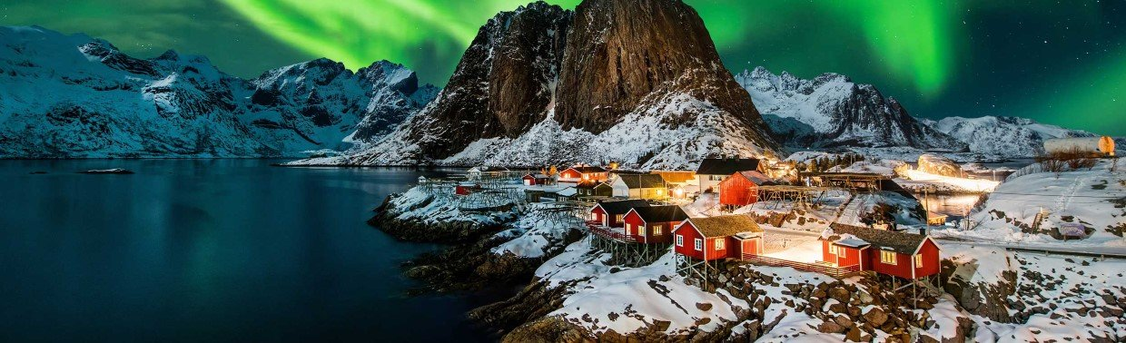 The Northern Lights dancing over Hamnoy in the Lofoten archipelago.